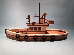 Hardwood replicas of tugboats and fishing boats of the